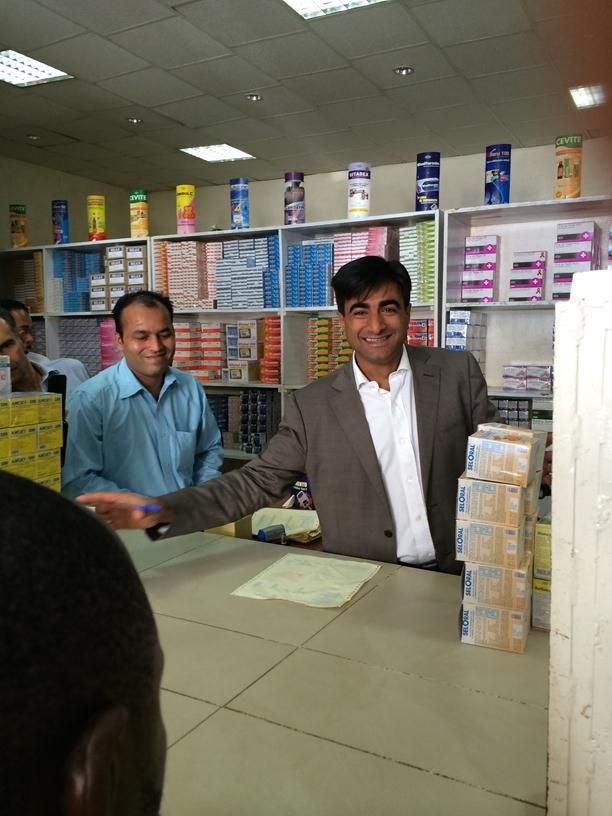 Abbas Virji, Co-CEO of Shalina Healthcare, serves customers at one of the Shalina depots in Luanda, Angola 1