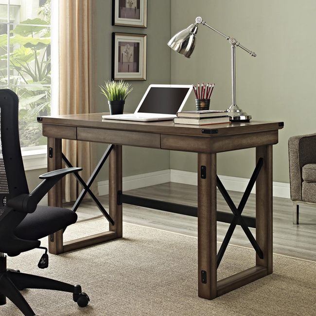 The Wildwood Rustic Desk desk offers a pull-out storage drawer, which provides convenient access to important files, folders or office supplies. A wide desk surface offers plenty of room for a laptop or traditional desktop monitor.