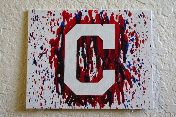 2016 AL CENTRAL CHAMPIONS  This Cleveland Indians silhouette on canvas board with melted red and blue crayon is great for all those artsy Tribe fans out there. This is melted on 8x10 inch canvas board. The crayon is very thick and raised in certain places making it textured. For an extra $1, I can add a sawtooth hanger to the back of the canvas. Mounted in the frame for an extra $15.  Why canvas board and not wrapped canvas? My method of melted crayons involves cutting directly onto the…