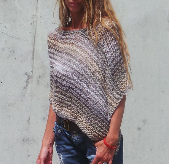 This hand knit, handmade poncho is so incredibly soft made from a mix of 60% Wool, 40% Acrylic, its light weight, warm, and very soft to the touch. . The colours blend back and fourth between a mid brown, mouse brown, caramel and ivory, creating a thin/thick stripe effect. Don't hide those curves! Show them off with this figure enhancing poncho; it covers the stomach but still shows off that dainty little waist and those curving hips. The shade is a graduating tone of brown Please allow 7…