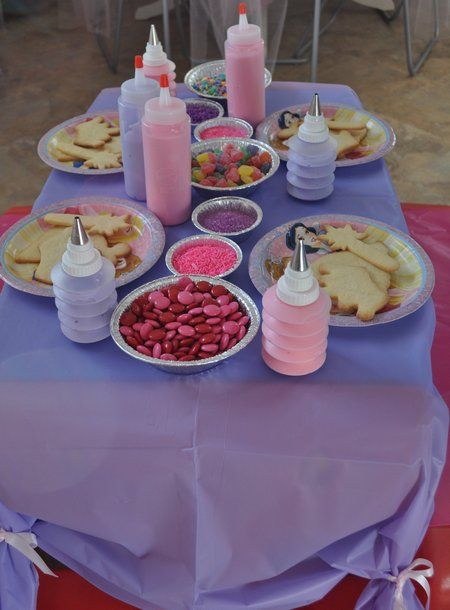 cute way of gathering plastic table cloth with ribbon to dress it up a little