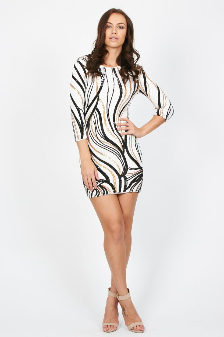The ultimate party dress of the season.<br /> <br /> - Crew neckline<br /> - Gold, black and white sequins <br /> - 3/4 sleeves<br /> - Body con shape<br /> - Regular fit<br /> - Concealed zip<br /> <br /> Care: Fabric 1: 100% Polyester<br /> Fabric 2: 94% Polyester, 6% Elastane<br /> Lining: 97% Viscose, 3% Elastane<br /> Hand Wash Only