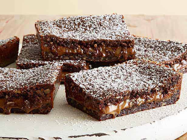 Knock-You-Naked Brownies Recipe : Ree Drummond :  German Choc cake brownies w/ caramel and Choc. chips filling. Yeah- she made up the name, not me!