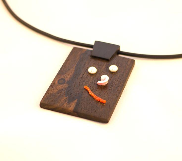 Bocote, Gaboon Ebony wood smile pendant.