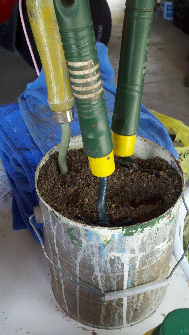 Havens South Designs likes this idea for keeping garden tools rust free and clean Fill a bucket with SAND and add a small can of motor oil