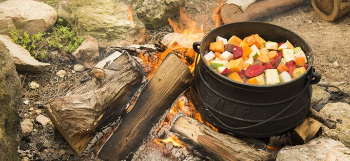 """Vegetable potjie. In South Africa, potjiekos /ˈpɔɪkiːkɒs/, literally translated """"small pot food"""", is a stew like dish that is cooked outside on an open fire."""