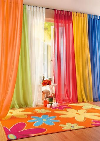 Sheer curtains have a beautiful flowy feel and filter natural light. This is such an easy setup and yet it looks so cheerful and happy! Bright happy colors make this a lovely place to kick back and entertain.