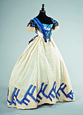 61: A cream challis ball gown circa 1863, the bodice an : Lot 61