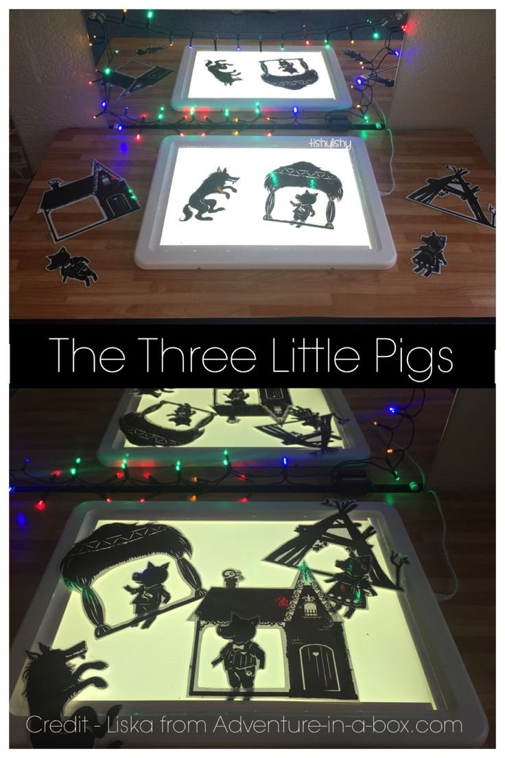 """The three little pigs on the light panel. Puppets from """"Adventure in a box"""""""