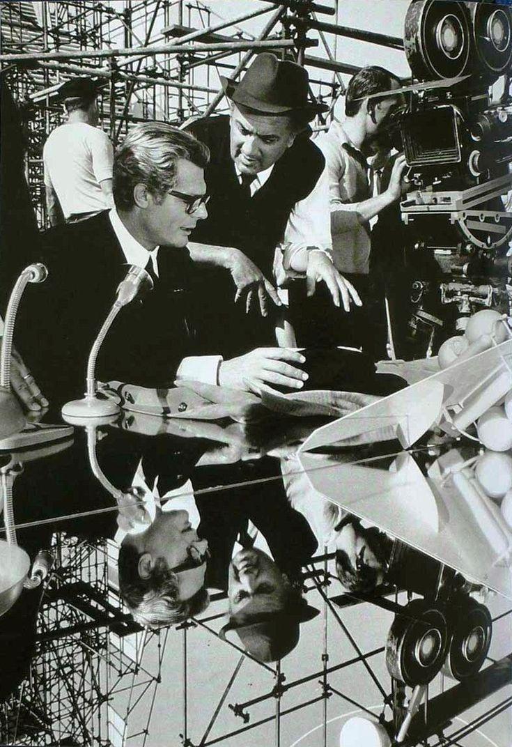 Federico Fellini and Marcello Mastroianni discussing the scene on the set of 8 1/2