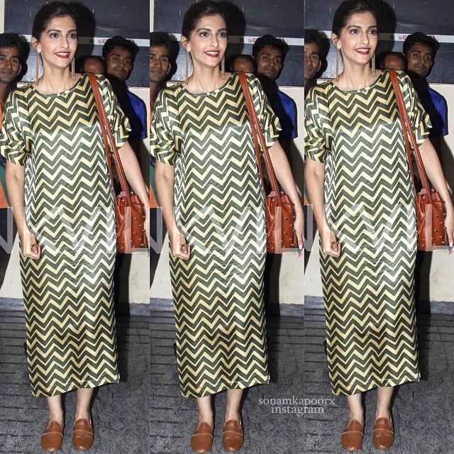 Sonam in Nimish Shah and earrings by Suhani Pittie with a Tod's bag at the screening of Dil Dhadakne Do