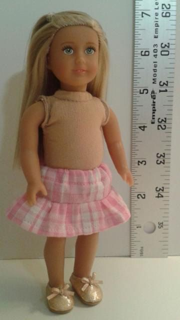 Ruffle skirt to fit the Mini 6 1/2 inch American Girl Doll. Skirt has elastic waist. You pick pattern.  Sewn in a smoke free home.  I am not