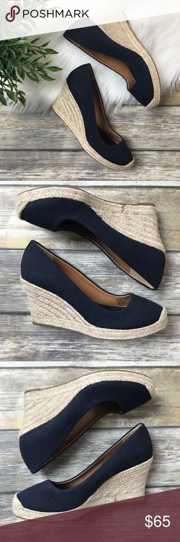 {J. Crew Factory} Canvas Espadrille Wedges | 6 These J. Crew factory canvas espadrille wedges are in great condition. They are never worn and nwot. They are size 6. Rubber/ jute sole. Navy blue color. Some glue minor spots from manufacturer (see photos).   Hight of heel: 3 1/3 in. Hight of full length in back: 5 1/2 in. Sole thickness: 1/2 in. J. Crew Factory Shoes Espadrilles