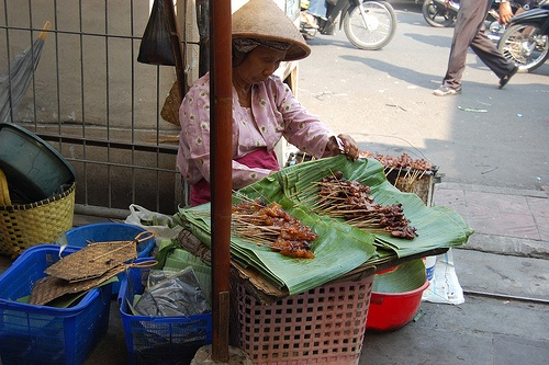 Sate Kikil.A woman selling satay at Beringhardjo Market, Yogyakarta - Indonesia