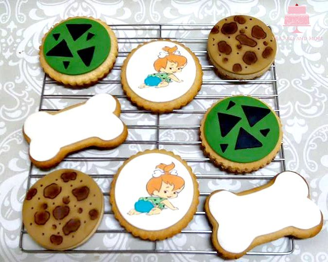 Sugar/shortbread cookies with fondant toppers. Pebbles/Flintstones theme.  By: YB Cakes and More www.ybcakesandmore.com