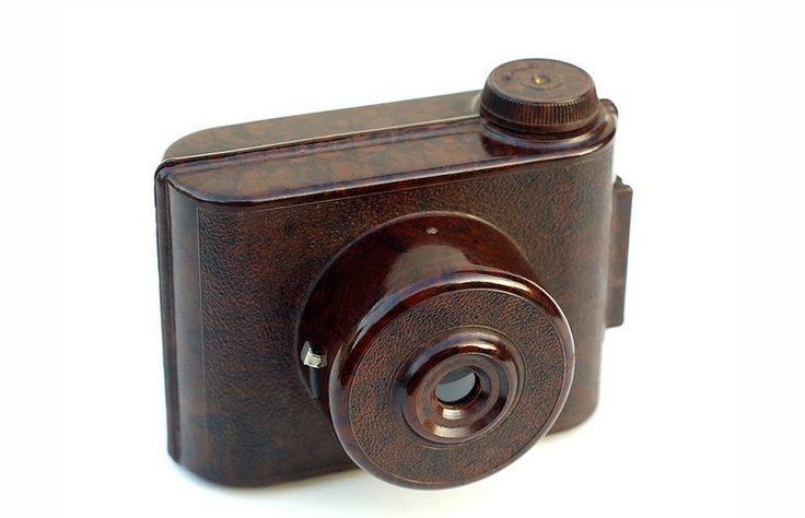 """V.P. Twin    Made by E. Elliott Ltd. in England, circa 1935, the V.P. Twin is a compact plastic camera that was originally sold at Woolworth's (UK) stores. It was available in black, red, green, blue, and the """"walnut marbled finish"""" shown here."""