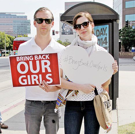 """Anne Hathaway, Adam Schulman Join """"Bring Back Our Girls"""" Rally - Us Weekly"""