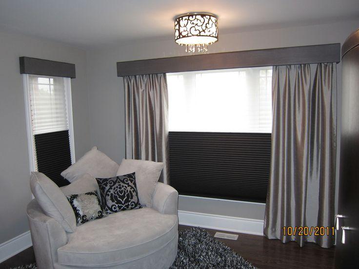 Silk drapes adorn this modern bedroom!