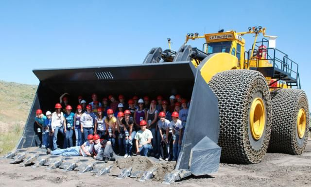 Students learn all about mining during Colorado's electric co-op energy camp. Here's they pose in the world's largest front-end loader.LeTournea L2350.The largest wheel loader ever built