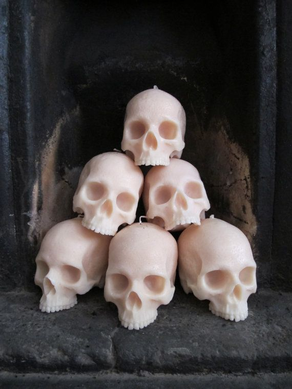 Stacked skull candles in the fireplace | an Architect Abroad / Halloween Roundup