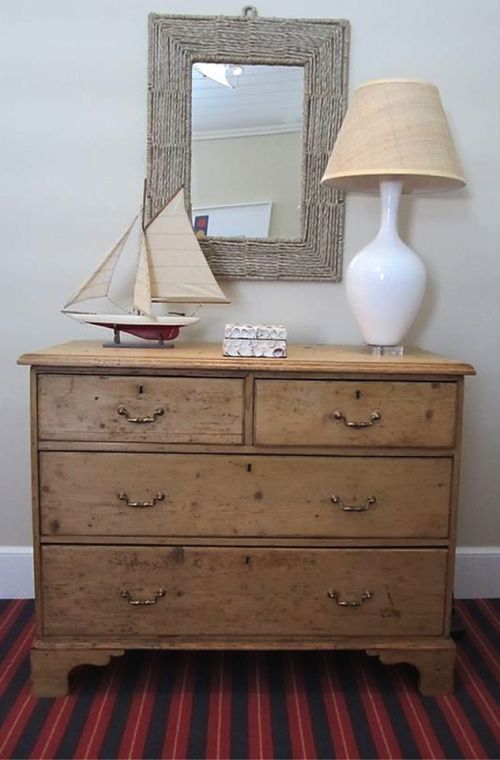 Marvelous Antique Pine Dresser With Striped Rug And Sail Boat, Under A Rustic Mirror.