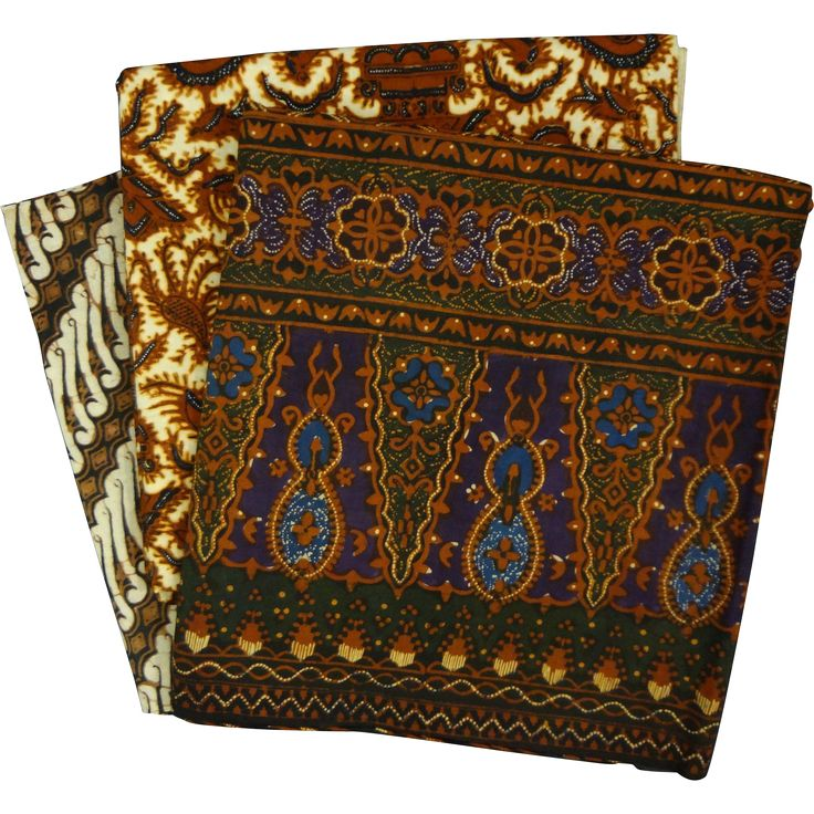 Three vintage Indonesian Batik pieces of cloth or Kain Panjang in three different patterns, wax dyed in traditional predominantly brown and blue