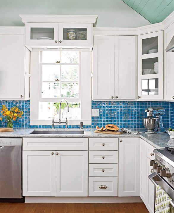 key west kitchen. Love the blue ceiling with the white cabinets