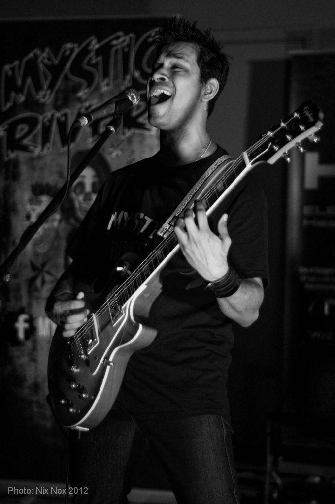 Vocalist and guitarist of Sydney based rock band, Mystic River.