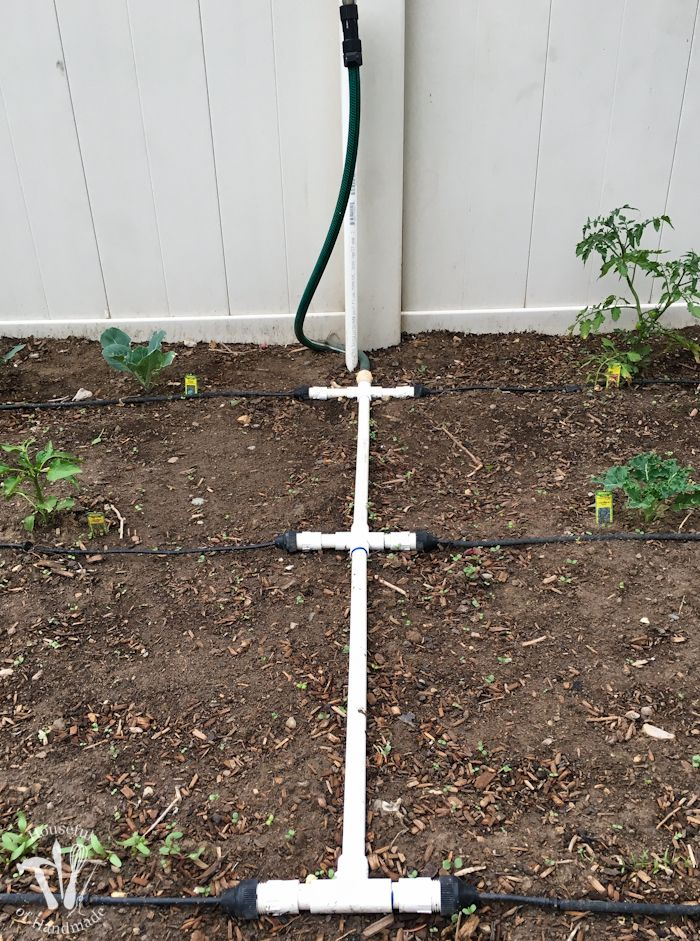 Ever wondered how to install a drip watering system for the garden? It is really easy to do and makes watering your garden so easy. Check out this great tutorial! | Housefulofhandmade.com
