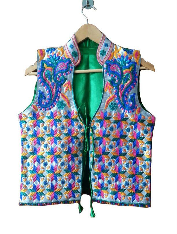 Phulkari Weaving Jacket  http://www.curiotown.com/Women-Apparel/Jackets/phulkari-weaving-jacket  Jackets are upgraded with mind blowing Phulkari weaving work. This green shade waist size coat with phulkari blueprint having strings in front will provide for you an immaculate ethinic look.  Price : 1800/- Product Code:CT/RO/12  Available: @www.curiotown.com