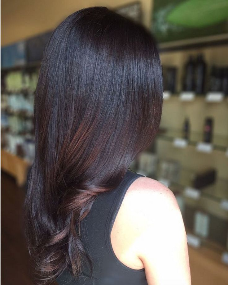 Picture-perfect shiny dark espresso brown hair color by Aveda colorist Chelsea Maritn.