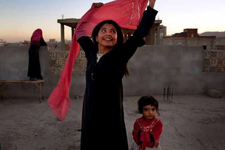 10 year old Yemeni girl smiling after she was granted a divorce from her husband - a grown adult.