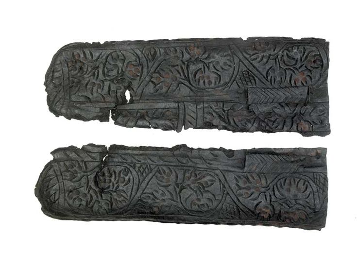 Sheath Leather knife sheath, now flattened open and in two pieces.Decorated on both front and back with incised foliate motifs and narrow panels of chevrons. The foliage is enhanced with impressed dots, possibly a scrolling vine. There are traces of red paint on the decorated surfaces. There is a side seam with edge/grain stitch holes. There are four suspension slots towards the opposite side to the seam. The sheath has a rather blunt, rounded end. Production Date: Late Medieval; late…