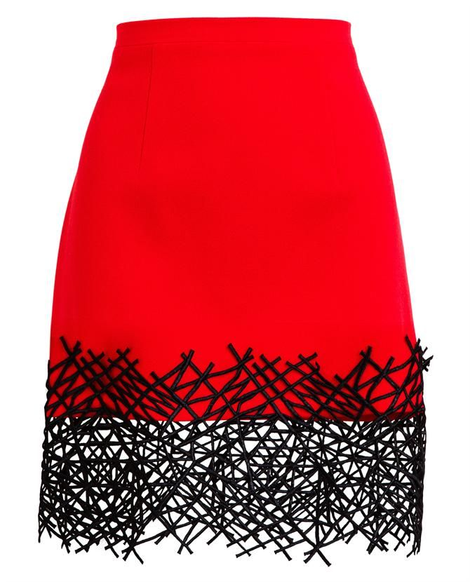 Red wool mini skirt with an embroidered cobweb hemline from Christopher Kane. Concealed zip down back.