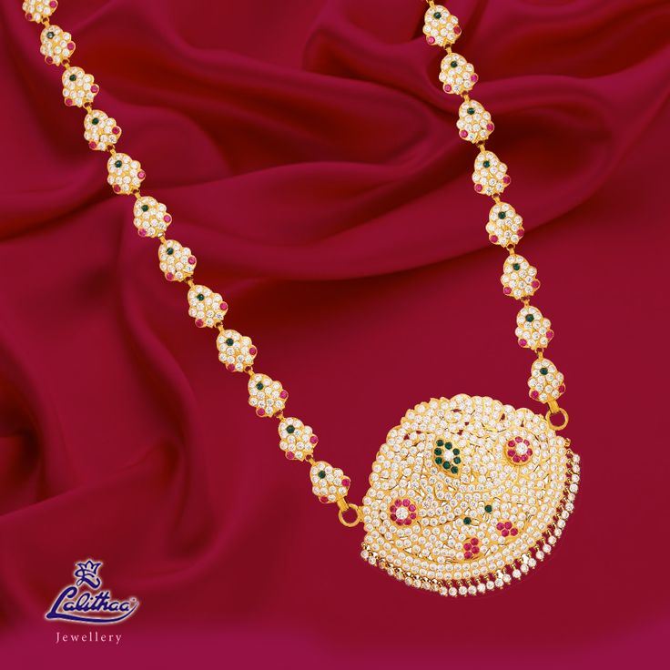 Adorn this multicoloured stone jewellery set that adds value to our tradition! For more collections visit - www.lalithaajewellery.com.