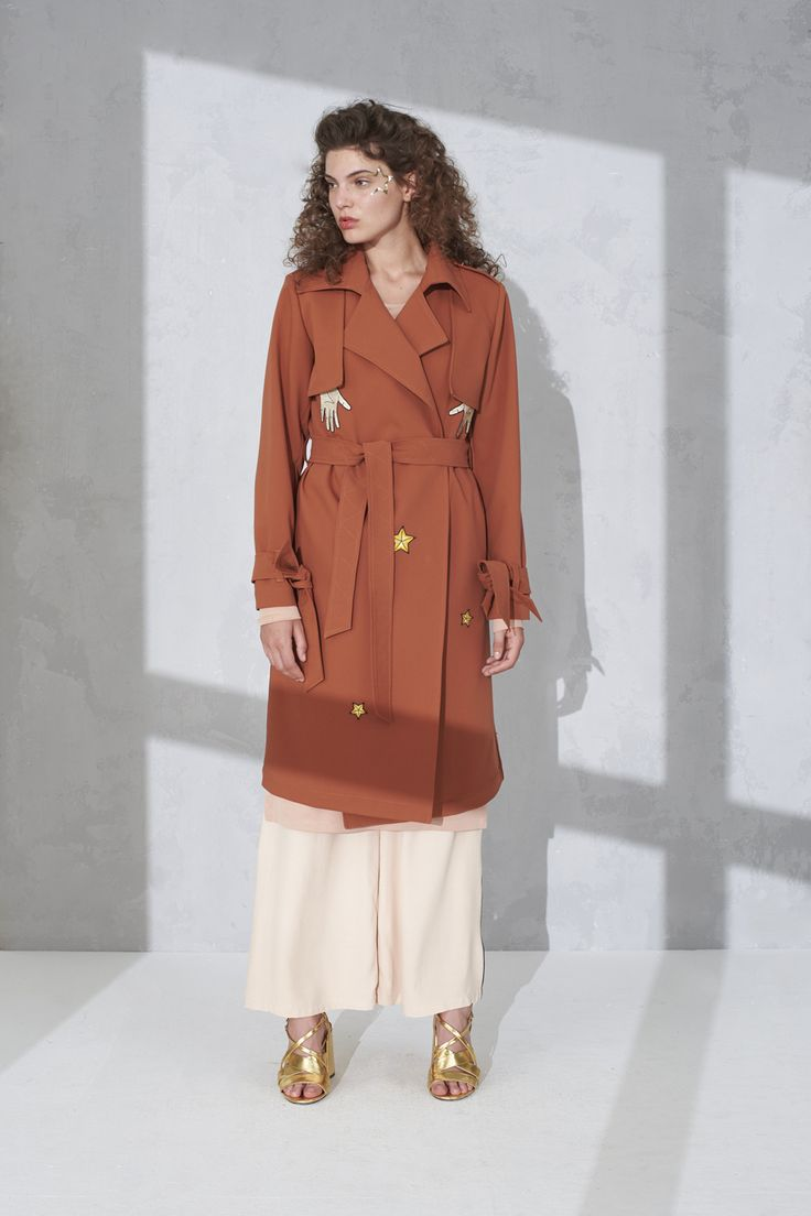 Unlined classic trench coat with badge detail and pipe detail trousers