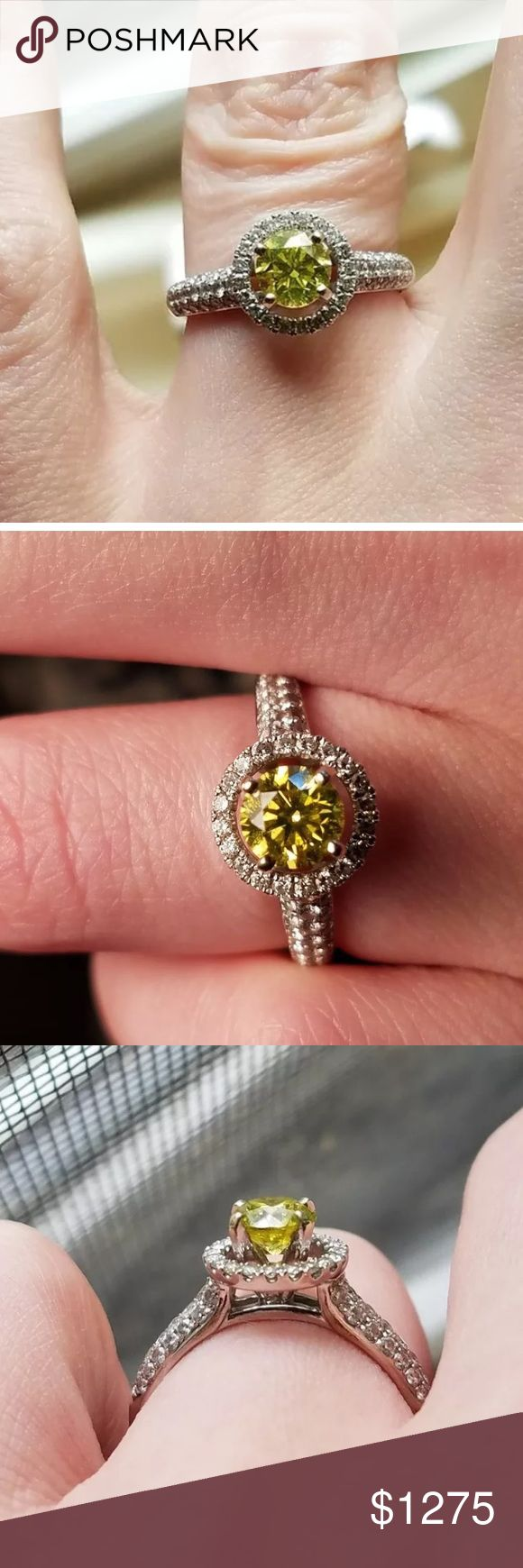 1.20 carat 18k white gold yellow diamond ring 1.20 carat 18k white gold yellow diamond ring! This is a vivid yellow 0.75 carat center diamond with a halo of white diamonds around it. Comes with appraisal. Jewelry Rings