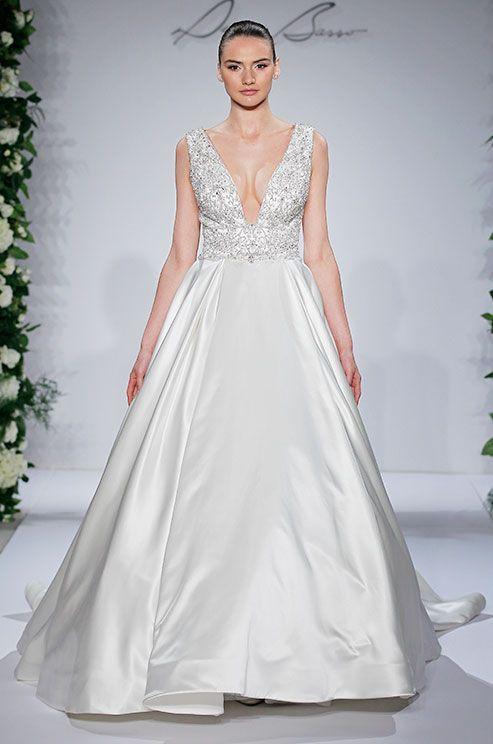 This Dennis Basso ball gown wedding dress features beautiful beading and deep V neckline.