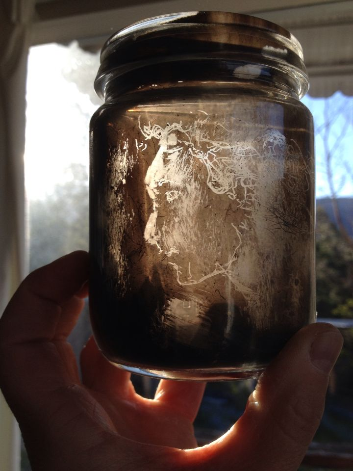 Woman, drawn in soot inside a preserving jar