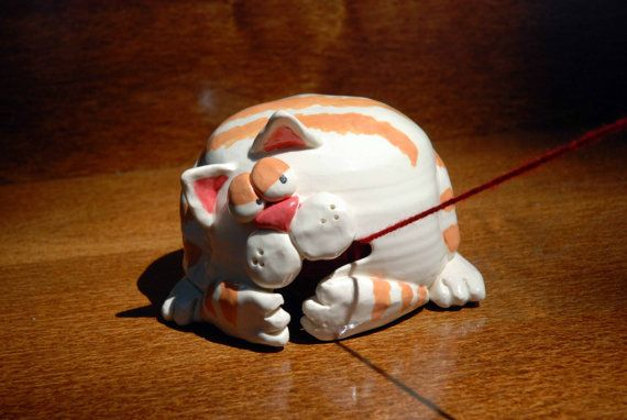 Honestly, could this get any more cute? I'm trying to stop the cats from eating the yarn. The irony!!! Cat Shaped Ceramic Yarn Bell