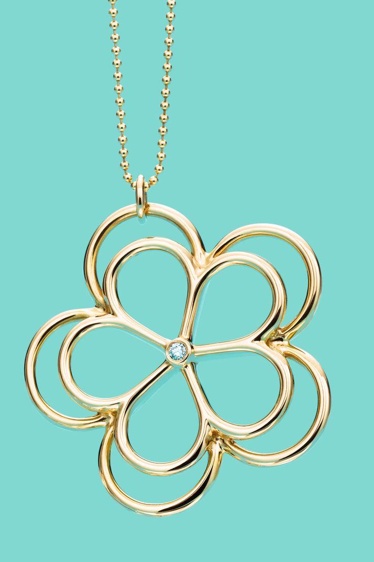 Tiffany Garden flower pendant in 18k gold with a diamond. #TiffanyPinterest
