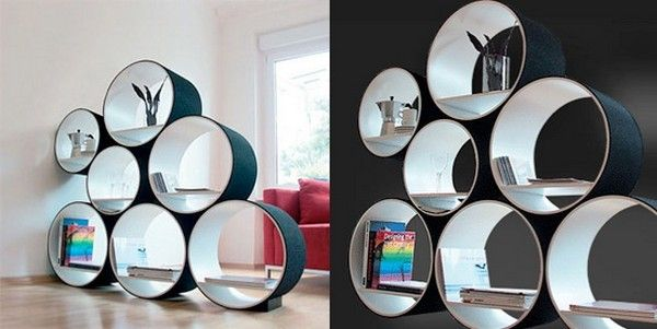 I bet this could be made out of huge PVC with the exterior sprayed with plastic spray paint in the color of your choice. The other option would be more industrial, using large cardboard tubes for pouring concrete columns found at Home Depot.