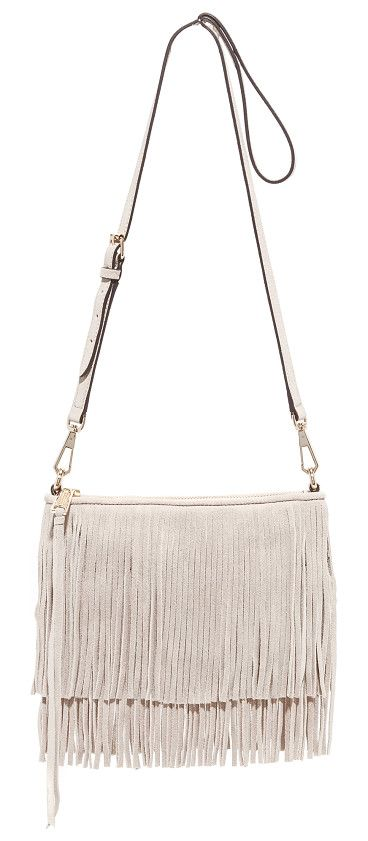 Finn cross body bag by Rebecca Minkoff. This soft suede Rebecca Minkoff clutch has tiered fringe on the front and back. The main zip opens to a lined interio...
