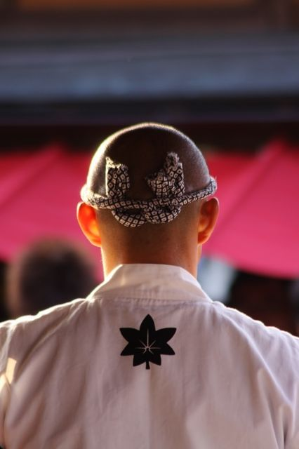 a twisted towel worn around one's head for a headband, Hachi-maki 鉢巻: worn as a symbol of perseverance, effort, and/or courage by the wearer in Japan.