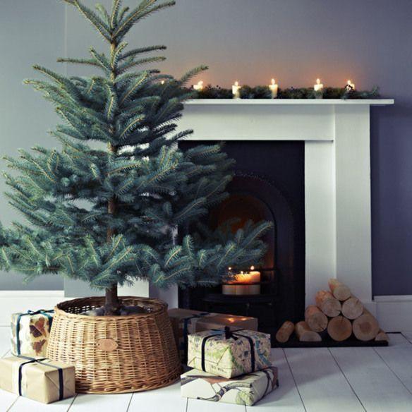 Scandinavian Christmas decor. Simple and minimal holiday decor. Christmas tree, basket tree collar, fireplace, candles, crate and barrel #ad #christmastreestand #baskettreecollar #crateandbarrel