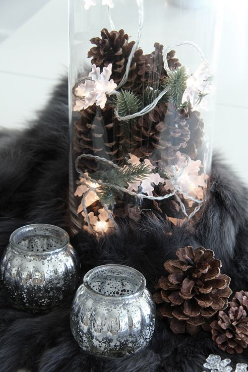 pinecones, lights, greenery, and candle decor