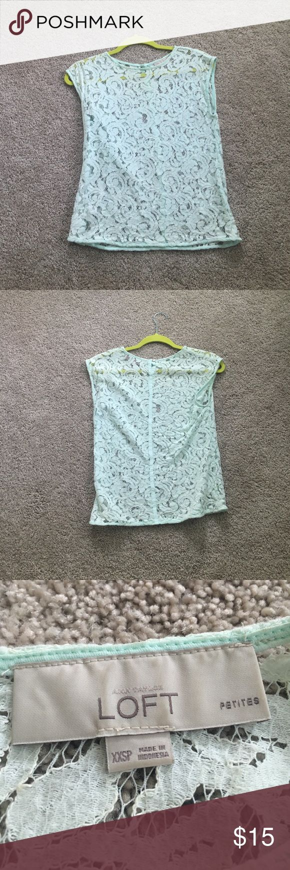 Aqua Lace Top This lace top looks great over any neutral tank. My personal favorites are navy and black. It does have some slight staining around the neck shown in the last picture from foundation but I think with some time and elbow grease it should come out. LOFT Tops Tees - Short Sleeve