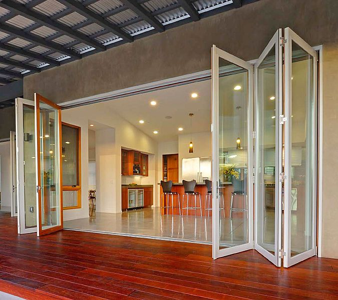 Great bi-fold wooden and glass doors, that ensure that all important indoor-outdoor flow!.
