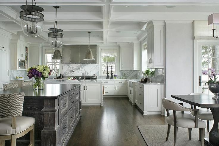 Urban Electric Company Dover Bell Lights boast an industrial touch to a large kitchen with two islands.