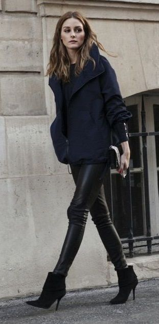 Olivia Palermo wearing leather leggings , an oversized coat and black booties